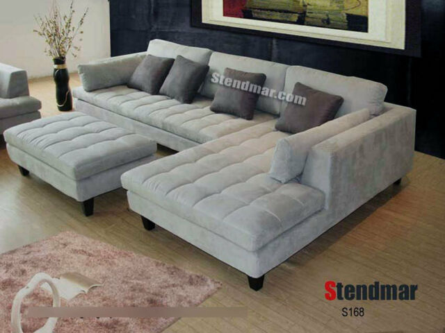 Modern Grey Microfiber sectional with round swivel chair decorative pillows