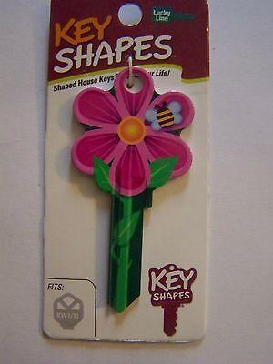 Flower shape Kwikset house key blank.
