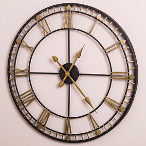 large wall mounted black gold skeleton wall clock roman numerals