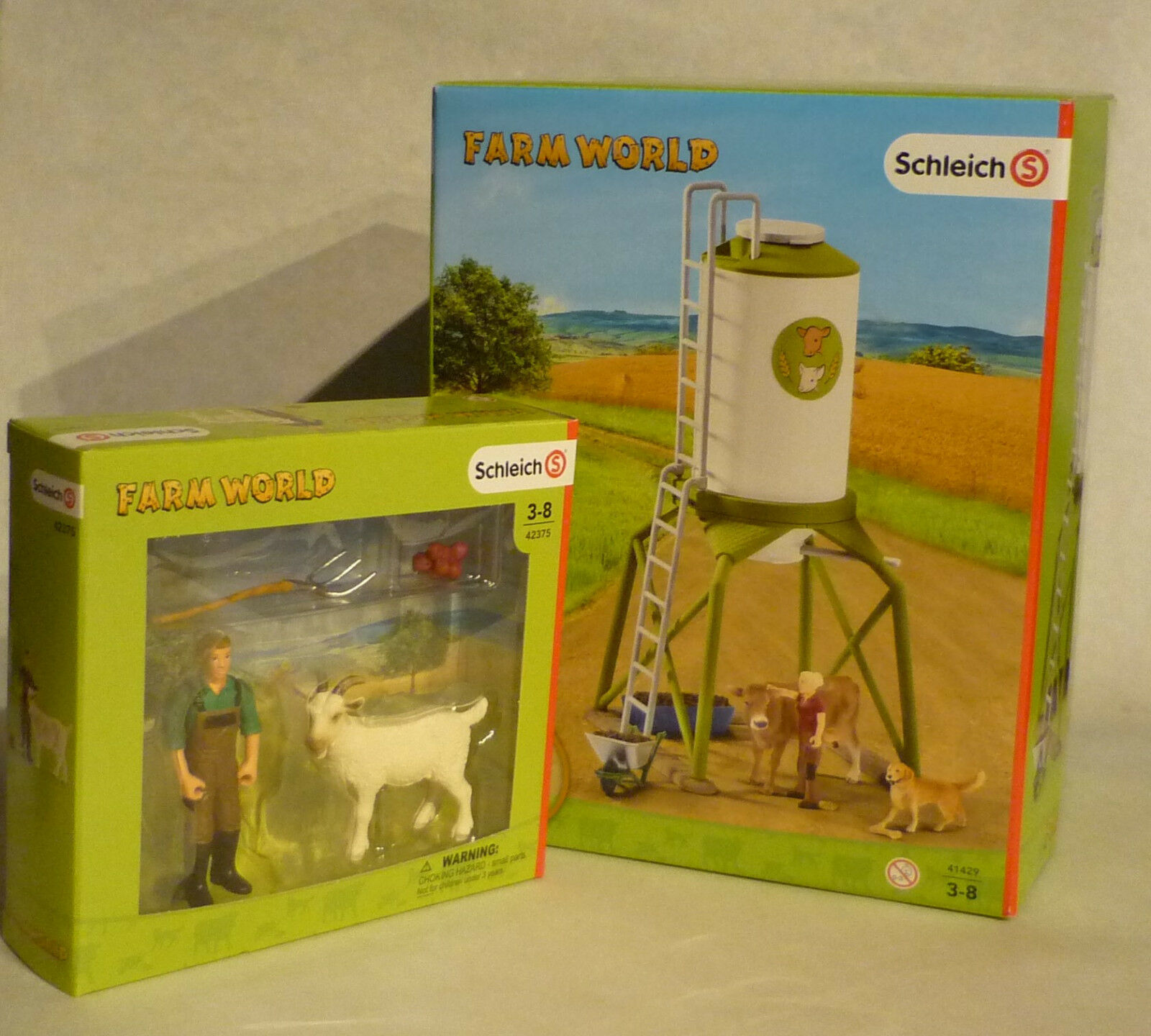 SCHLEICH SET 41429 + 42375 Futtersilo mit Tieren + Bauer mit Ziege NEU