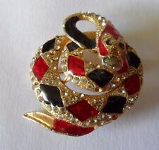 Vintage brooch designed as a coiled snake with red and black panels and diamante