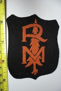 Canadian Royal Mounted ? vintage wool patch R M with a Pine Tree