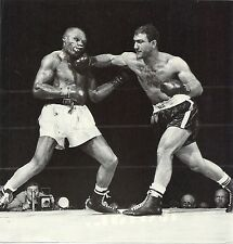 THE GREAT ROCKY MARCIANO DELIVERS KNOCKOUT PUNCH TO JERSEY JOE WALCOTT