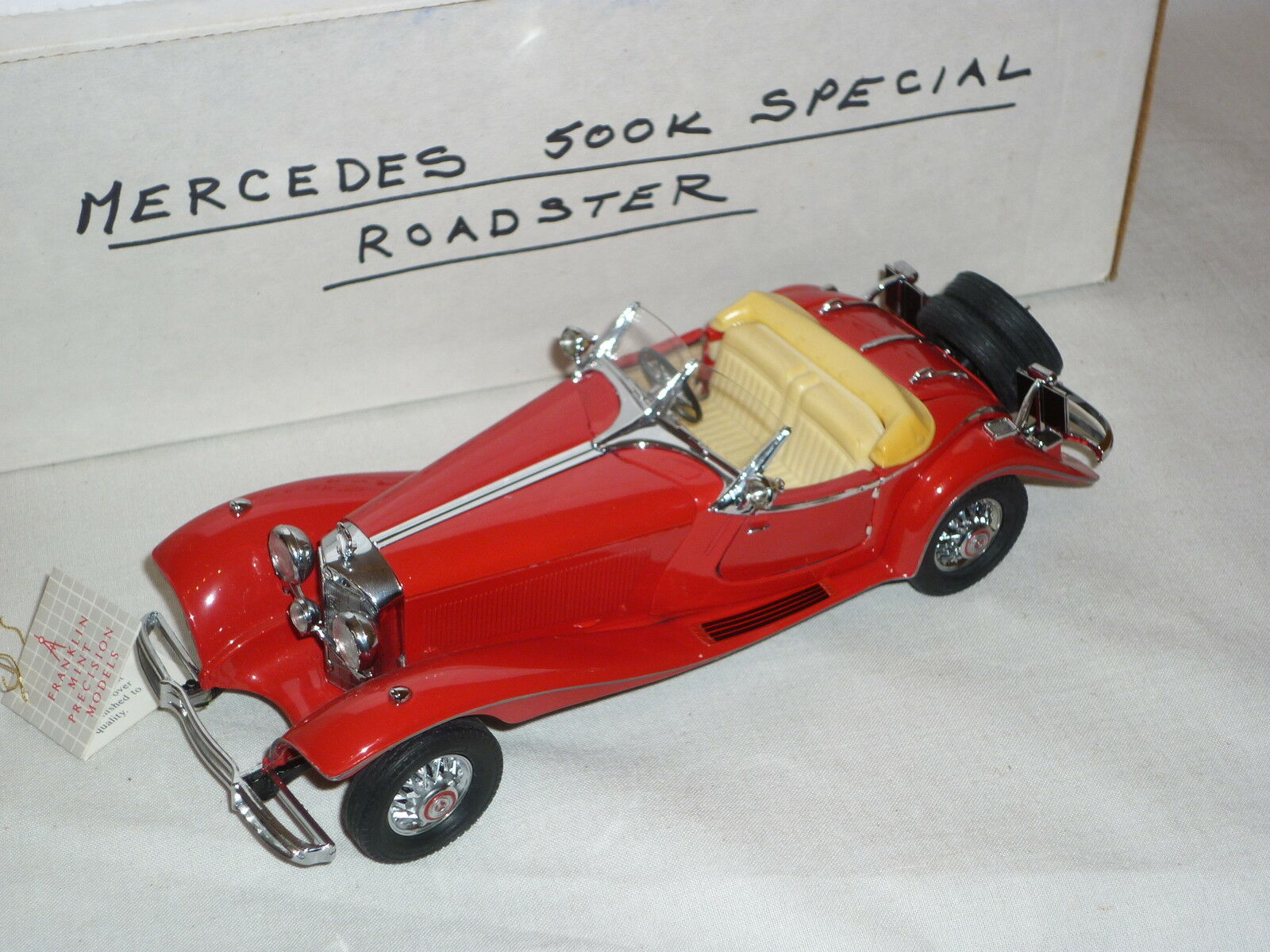 A Franklin mint scale model of a 1935 Mercedes benz 500k Roadster,  boxed