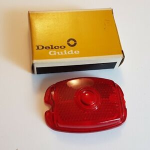 New in box Delco Part 5937162 1937-53 Chevy Tail Light Lens
