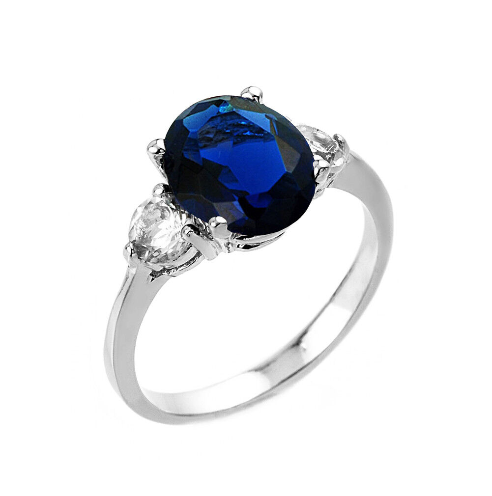 2.0 CTW Oval Lab Created Sapphire Three Stone Engagement Ring in White gold