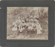 ANTIQUE IMAGE, GROUP OF MEN AND WOMEN WITH INSTRUMENTS AND A DOG.