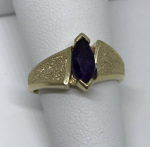 Gorgeous cocktail ring estate oval amethyst colored stone with Tanzanite halo in 10 karat gold FP