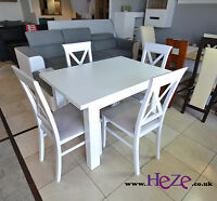 Extending dining table on its own or with 4 lovely chairs, white colour