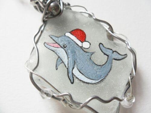 Happy dolphin wearing santa hat hand painted sea glass christmas tree decoration