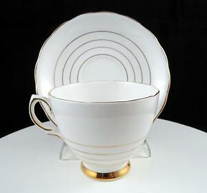 ENGLAND-BONE-CHINA-GOLD-RINGS-2-3-4-034-FOOTED-CUP-AND-SAUCER-SET
