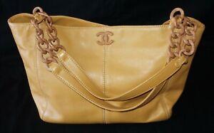 Vtg. Camel Colored Leather Shoulder Bag w. Wooden Logo & Straps by Chanel (ReR)