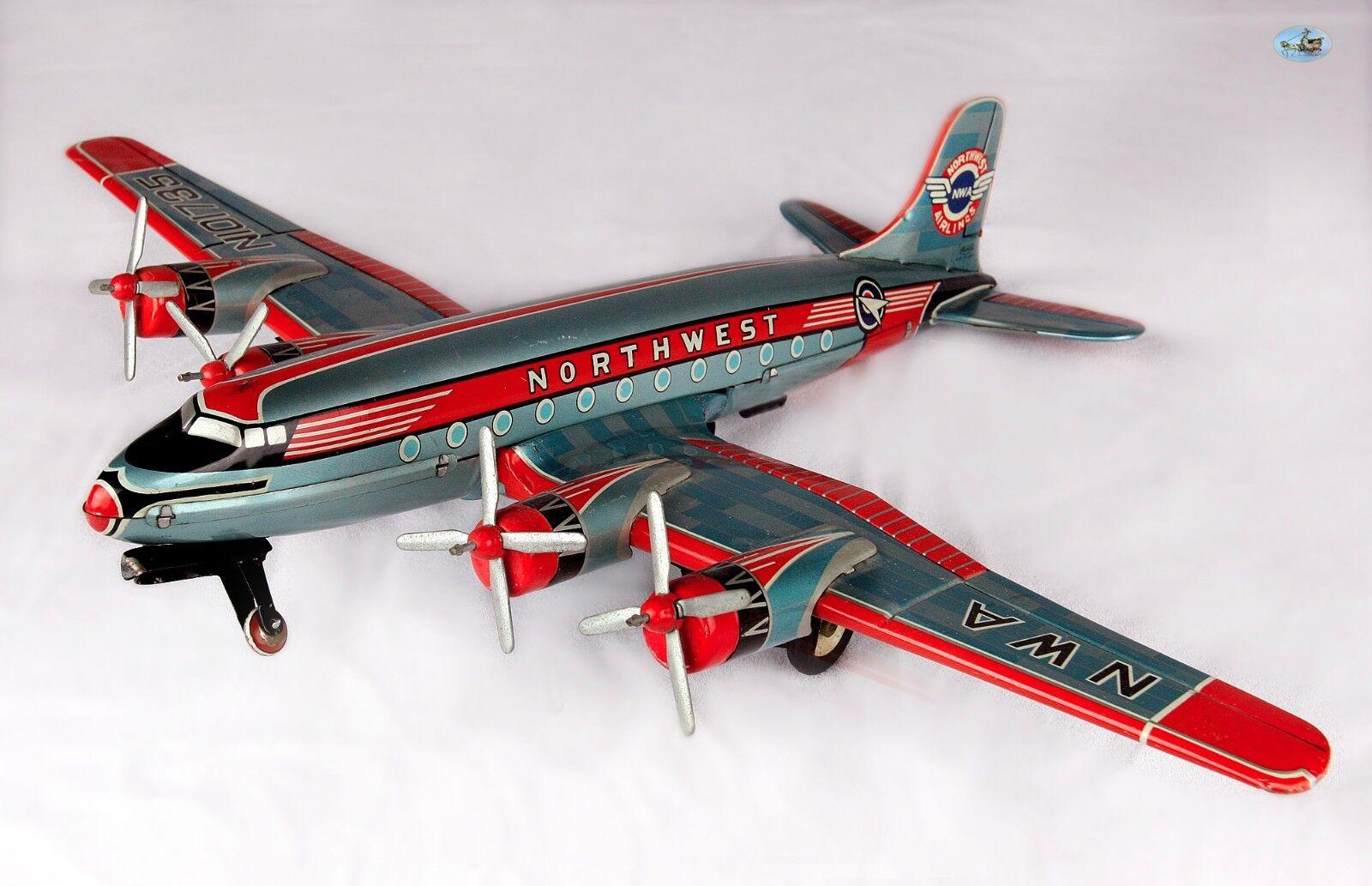 Raro grandes NWA Northwest Airlines 4 Prop Motor de estaño de juguete avión Asahi Japón