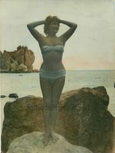 Erotic-woman-in-bathing-suit-on-beach-antique-photo