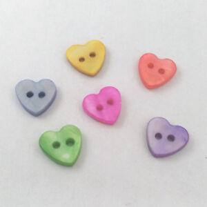 lote-de-30-perlas-BOTONES-CORAZONES-HEART-2-AGUJEROS-NACAR-NATURAL-10mm