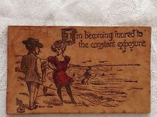Leather Postcard Edwardian era - saucy, suggestive lady in bathing suit at shore