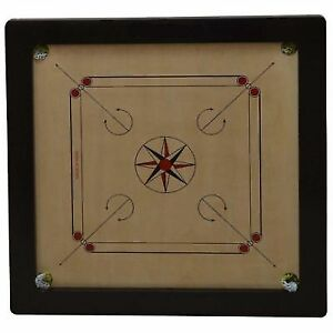 carrom board coins and striker