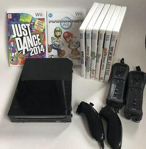LOT Nintendo Wii Console Bundle 2 Remotes 2 Nunchucks 8 Games Mario Kart Wheels