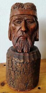 Tete-en-bois-sculpte-a-identifier