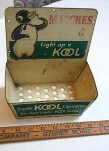 VINTAGE-KOOL-CIGARETTES-POS-MATCH-HOLDER-EMBOSSED-METAL-GREAT-CHARACTER-PIECE