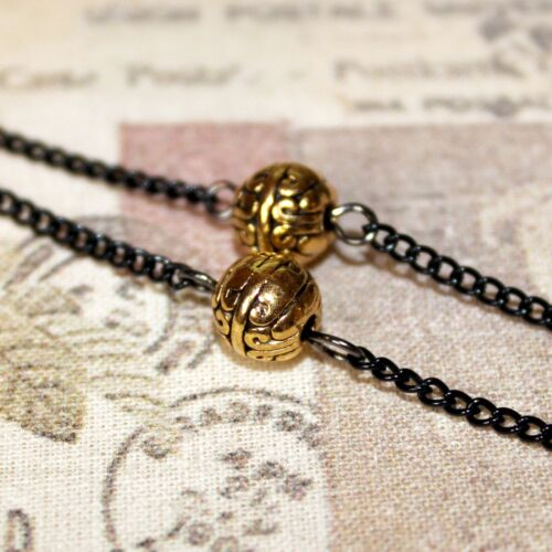 Flapper//Gatsby//1920/'s long black gold necklace with carved deco beads /& tassel