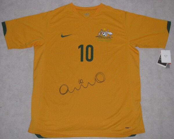 Harry Kewell mano firmado 2010 Australia Fútbol Remera enorme firma  prueba fotográfica