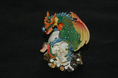 "Small Dragon Perched On Skull Figurine- Poly Resin- 3/""L x 2/""W x 3 1//4/""H"