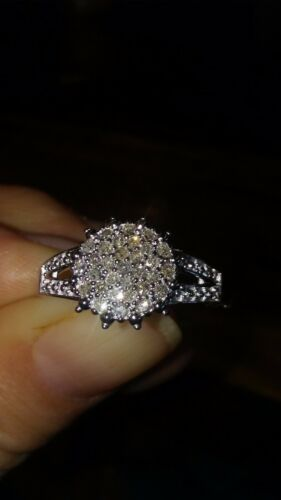 .925 sterling silver diamond cluster ring by Avon.size 10
