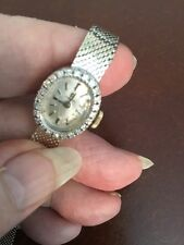 14K Gold Swiss Omega Watch With Diamonds Around Face.  Works Wonderfully!
