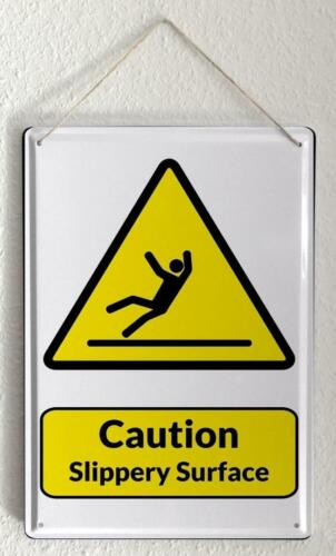 Tin Sign Warning Sign Caution Slippery Surface man symbol in black and yellow