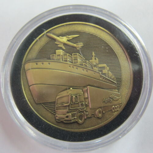 Agility Defense & Government Services Logistics Challenge Coin Plane Boat Truck