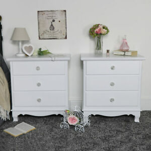 Pair-of-ornate-white-wooden-chest-of-drawers-vintage-French-bedroom-furniture