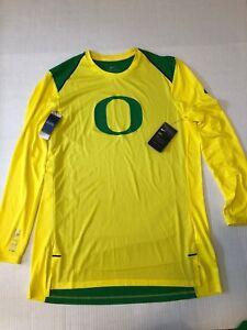 8b9cf5ec9bb4 Men s Nike Oregon Ducks DRI-FIT Elite Shooter Long Sleeve Shirt ...