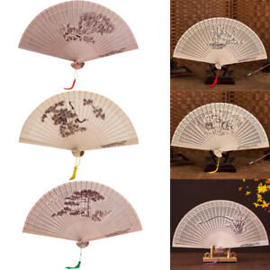 Chinese-Traditional-Hollow-Fan-Wooden-Hand-Made-Exquisite-Folding-Wedding-Fans