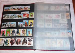 Grand-album-32-pages-rempli-timbres-animaux-surtout-chiens-et-chats