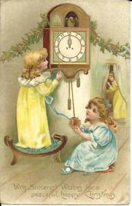 EMBOSSED-CHRISTMAS-GREETINGS-CHILDREN-WATCHING-CLOCK-c1910
