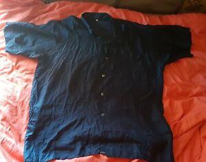 Chemise manches courtes en Soie taille L bleue marine