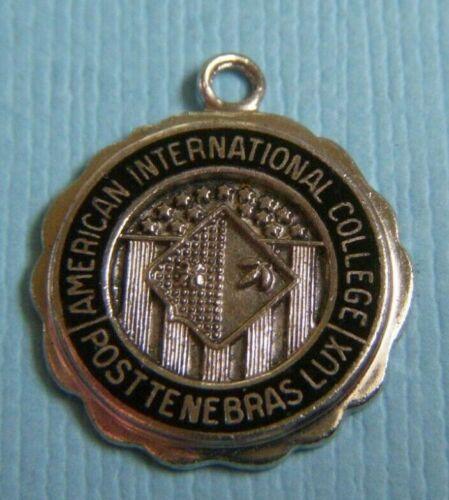 Vintage enamel American International College Mass