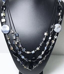 Triple-Strand-Black-Lip-Shell-Necklace-Accented-With-Faceted-Black-Beads
