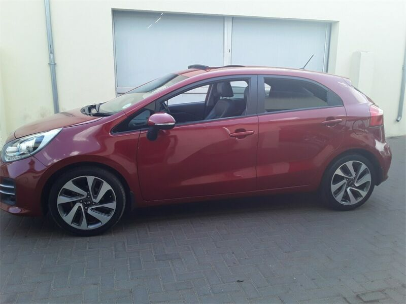 Red Kia Rio 1.4 5-door AT with 51000km available now!
