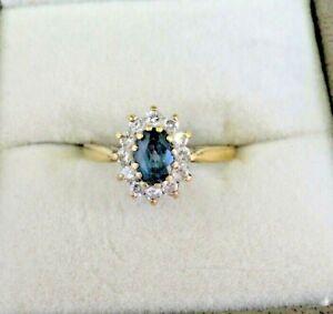 Vintage-solid-9-carat-gold-Topaz-and-CZ-Cluster-ring
