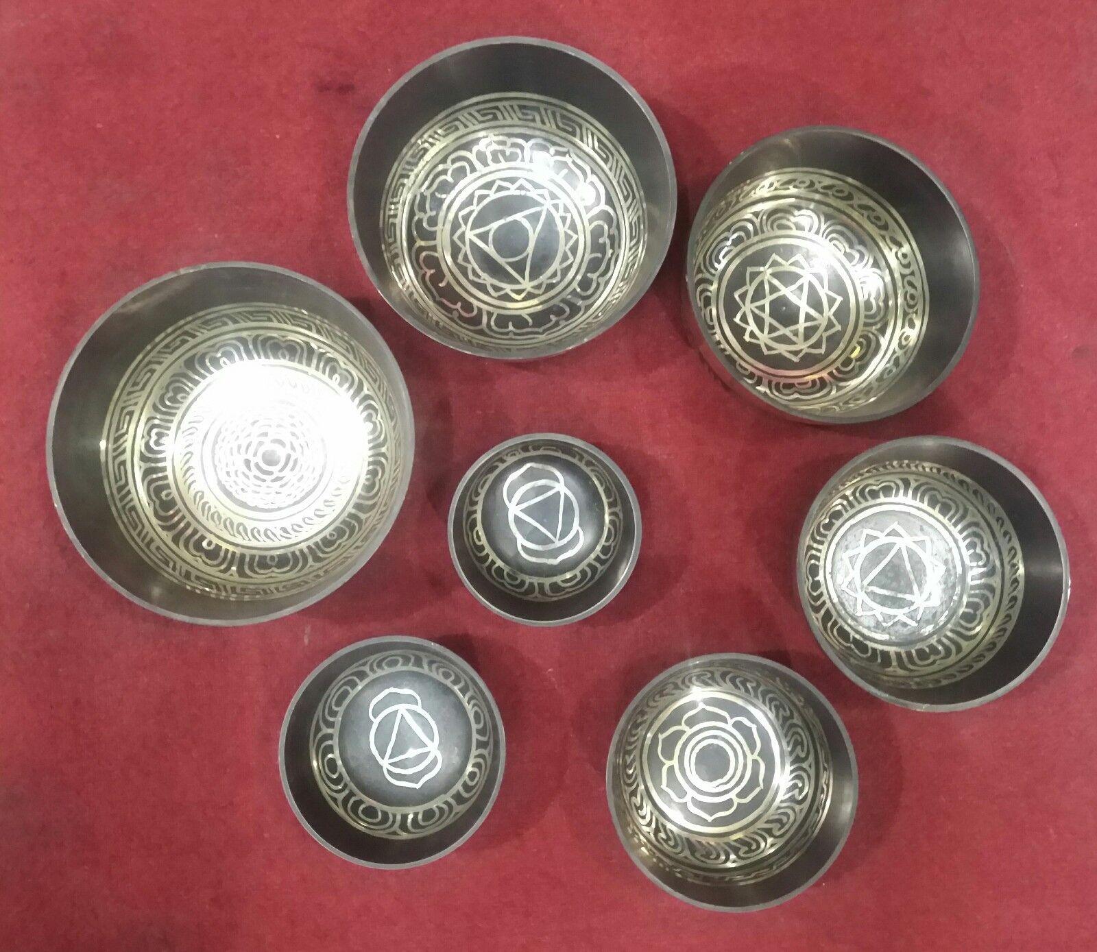 Tibetan  Singing Bowls set  Bronze  Hand made Chakra symbols etched 7 pcs