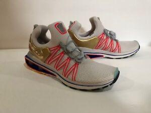 3a3d6b1f843d4e Nike Shox Gravity Olympic Shoe Sizes Vast Grey Metallic Gold AQ8553 ...
