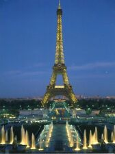 POST CARD OF THE EIFFEL TOWER IN PARIS FRANCE AT TWILIGHT WITH BLUE SKY BACKDROP