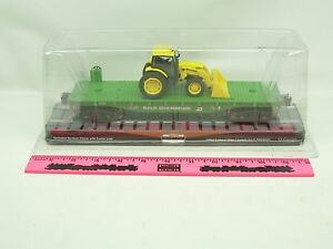 Menards ~ Burlington Northern flatcar with Tractor load