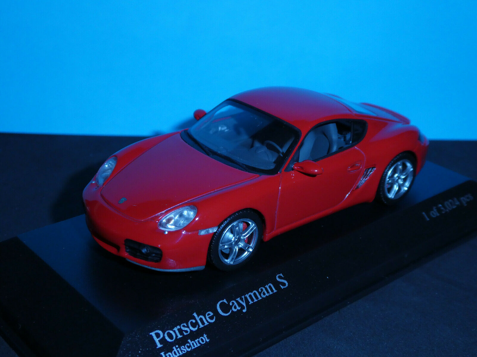 Porsche Cayman S in Indischred from 2005   NLA Very Rare Minichamps model.