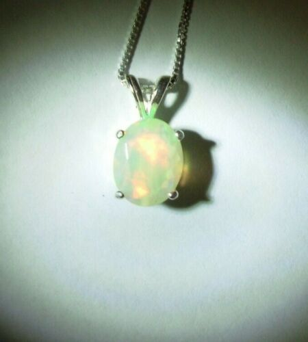 Details about  /WELO ETHIOPIAN OPAL PENDANT NECKLACE EARTH MINED FACETED 9X7MM GEM!