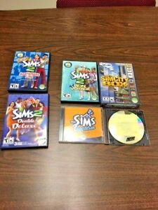 11-Assorted-Sims-PC-Games-most-with-cases