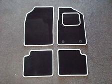 Ford KA (09-12) Black Carpet With White Leather Look Trim Car Floor Mats Set