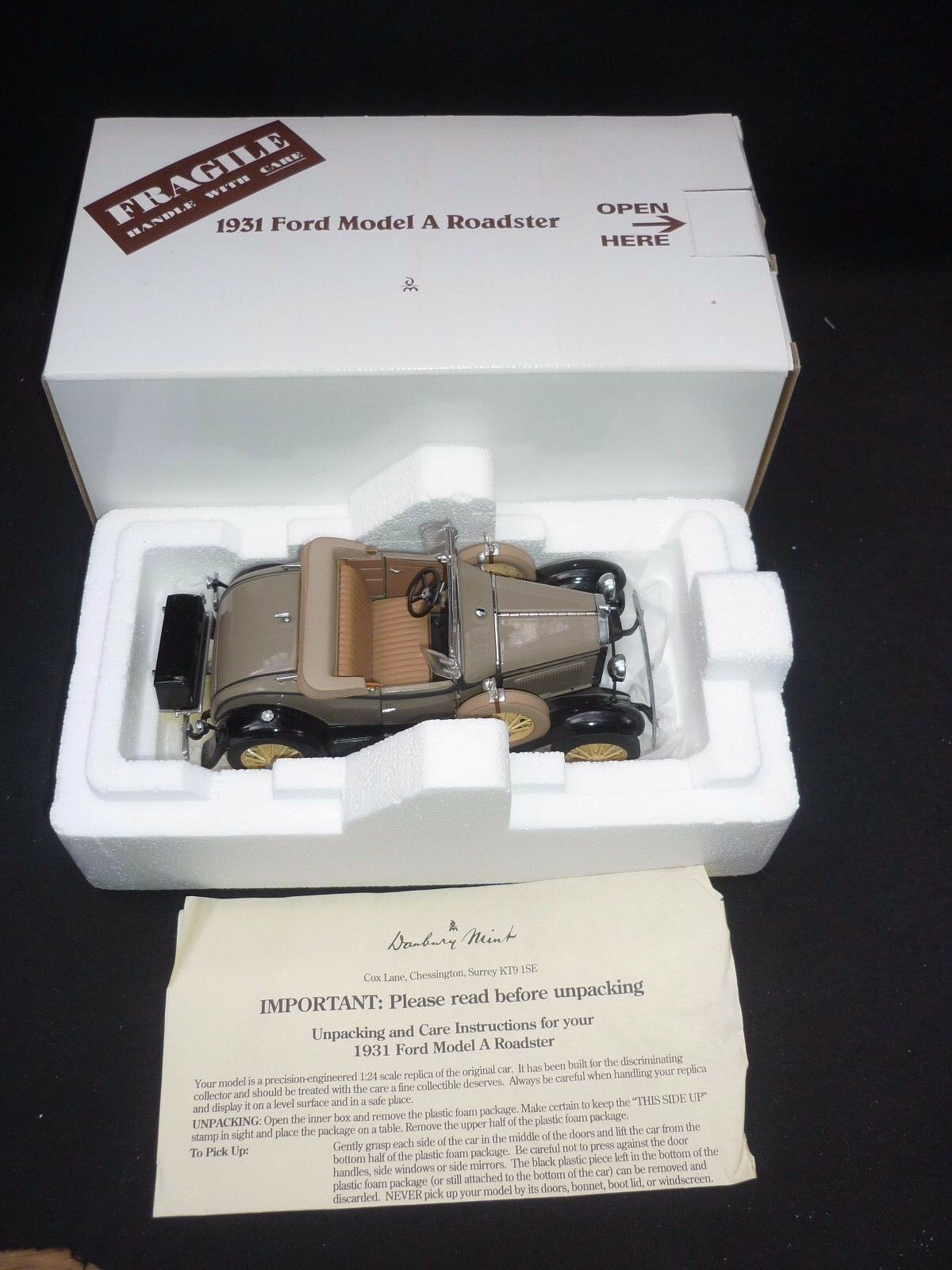 A Danbury mint scale model of a 1931 Ford model A Roadster,  boxed